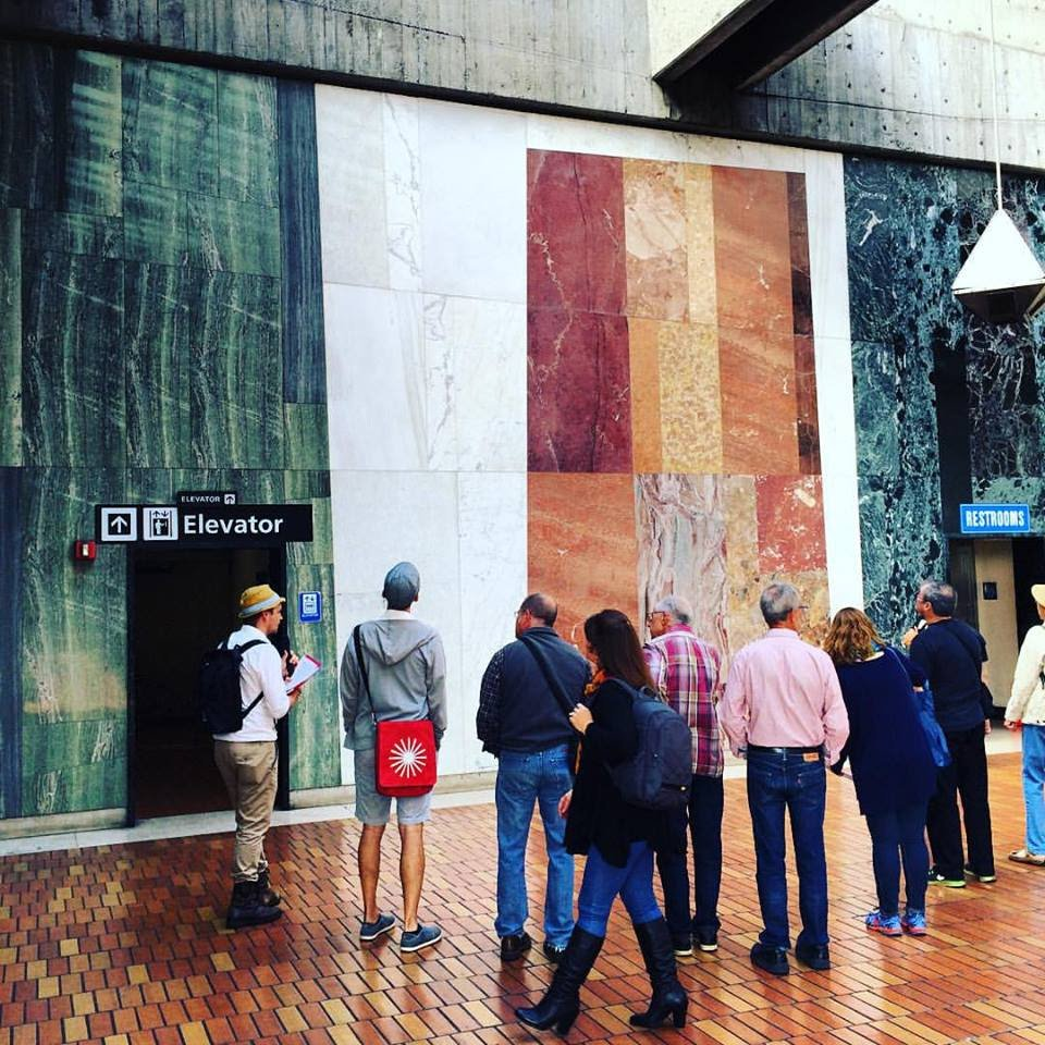 Viewing a marble mural at the Glen Park BART station on our walking tour of the history and design of BART