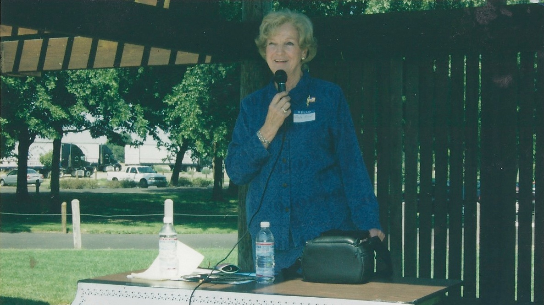 Greta Nord speaking at a job fair.
