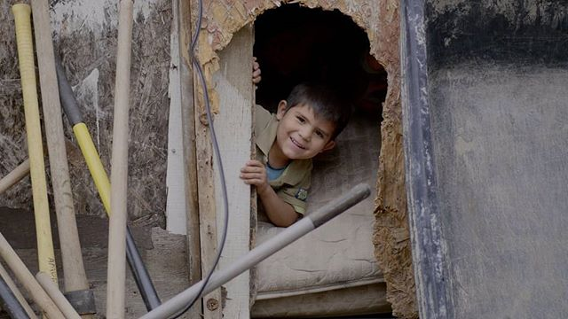 According to that smile I think he might miss his little hole he can slide out of... but now he will stay dry in his new home that was built this weekend in Tijuana, Mexico. @amorministries