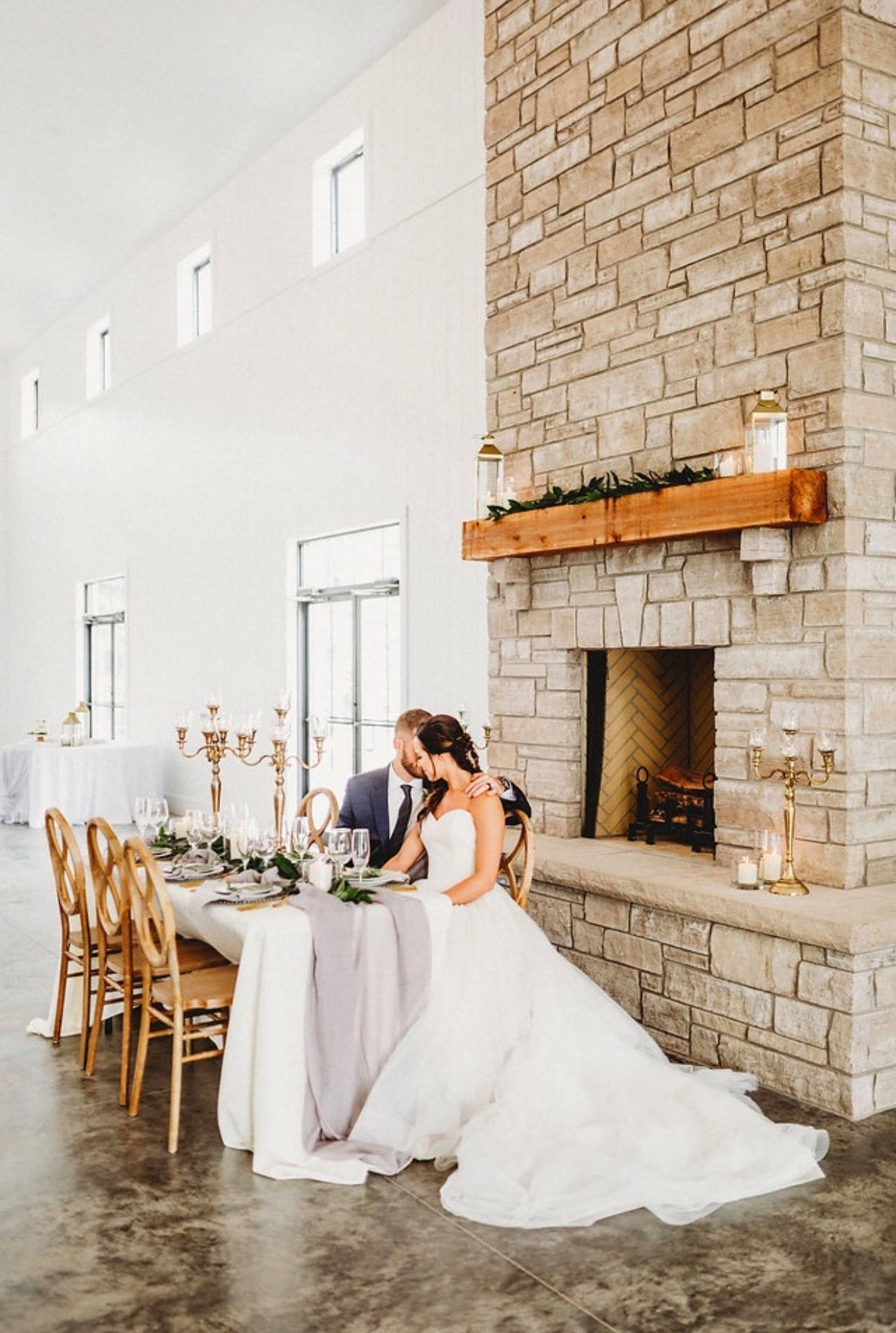 Modern Barn Weddings - Like a page from a fairy tale, our brand new barn chapel is both whimsical and functional. The towering 20 foot shiplap walls soar to the giant farmhouse chandeliers. An indoor/ outdoor stone fireplace will be ready to keep your guests warm as they converse or play corn hole under our cedar pergola. With a commercial kitchen, bar service and space for 250+/-, this venue is perfectly crafted to meet your needs.