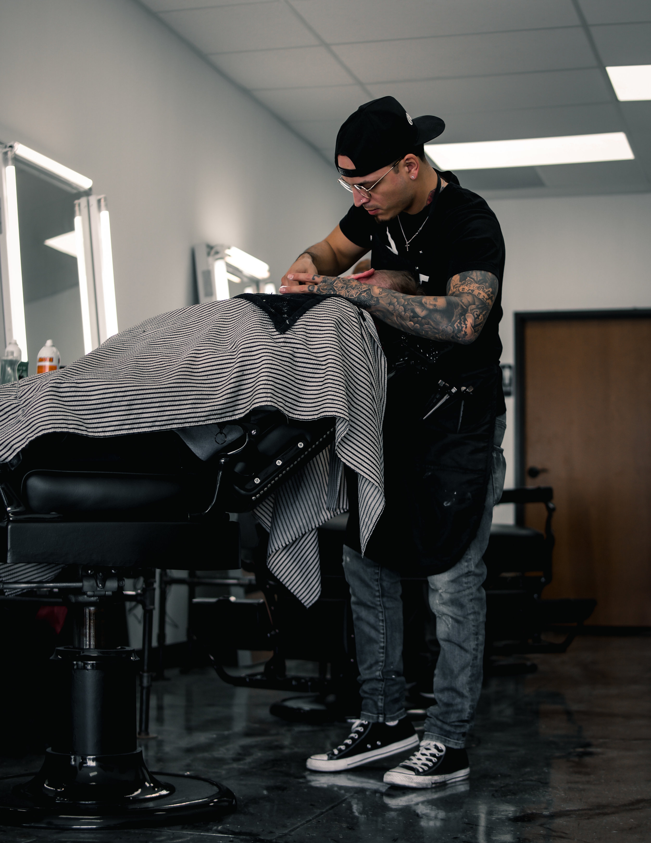 Julian Palafox - The Owner of Revolt Barbershop, Julian Palafox has been a licensed Barber in the Dallas metroplex specializing in men's hair styles, facials, and hot towel straight razor shaves for over 12 years. After working for several mens luxury shaving lines for more than 6 years and also accomplishing creating his own mens product line in 2018 he decided to venture off into establishing Revolt Barbershop, a Refined Urban Barbershop in the heart of Oak cliff, Tx.