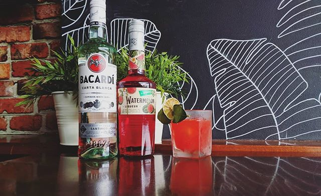 """Introducing the """"Forbidden Fruit"""" By our very own @forstdy Perfect drink for a warm summers day by the beach. Using the newly branded De Kuyper Watermelon, In house made kafir lime leaf infused Bacardi & An In house tumeric infused Bacardi With a squeeze of fresh lime - - - - - - #sunsetbar #sunset #bar #beach #cocktails #drinks #bacardi #dekuyper #dylansdeliciousdrinks #fridaynight #spirits #rum #liquer"""