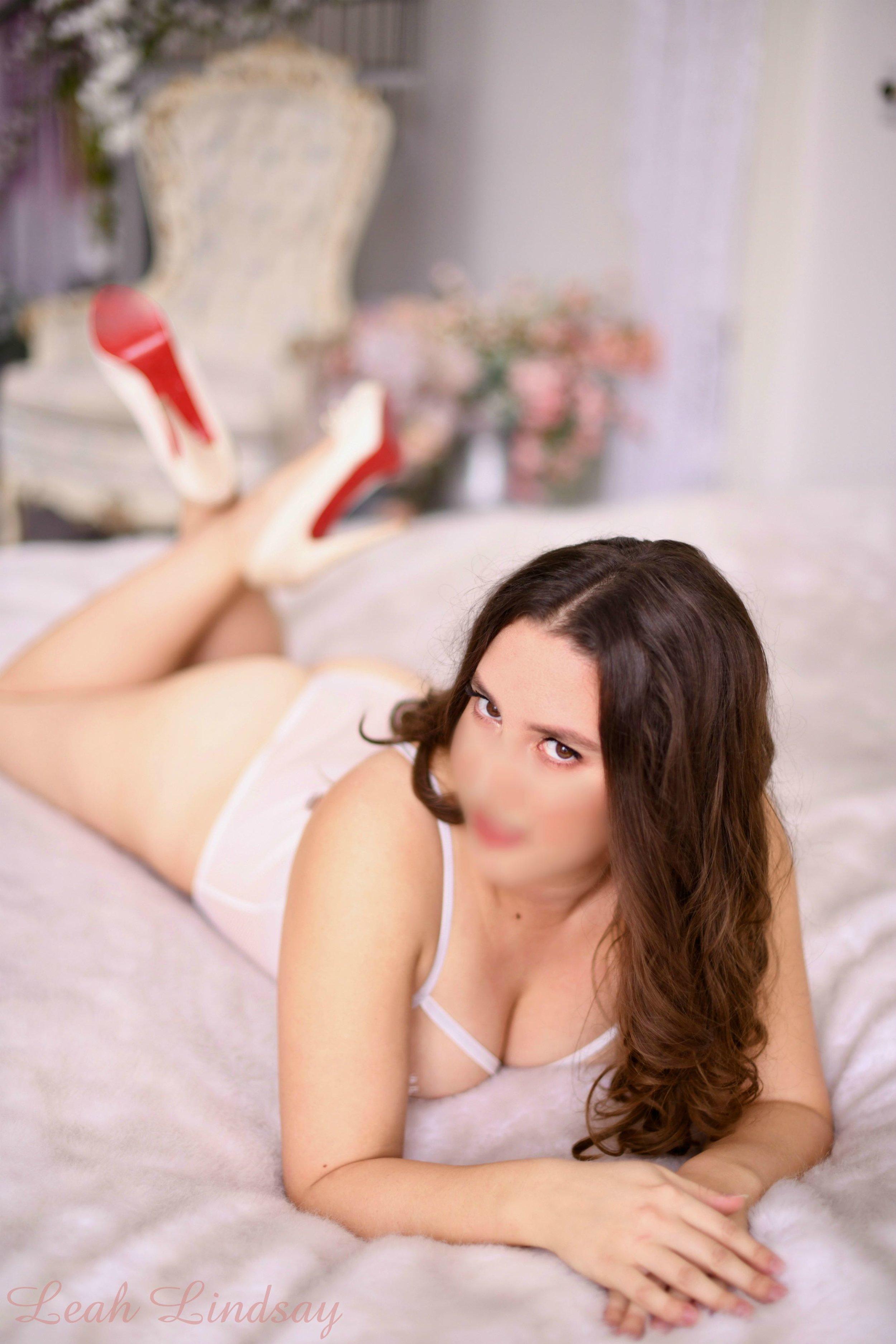 Leah Lindsay - Bed Ankles Crossed.jpg