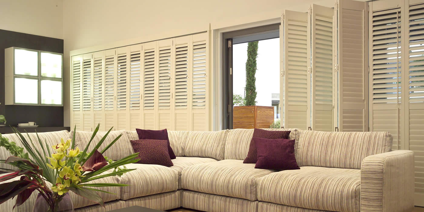 Tracked Shutters      Available in two styles, tracked shutters offer you a gliding system for opening and shutting. Bi-fold shutters – concertina style – are great for garden rooms and By-pass shutters – slide past each other – are perfect for sliding doors.