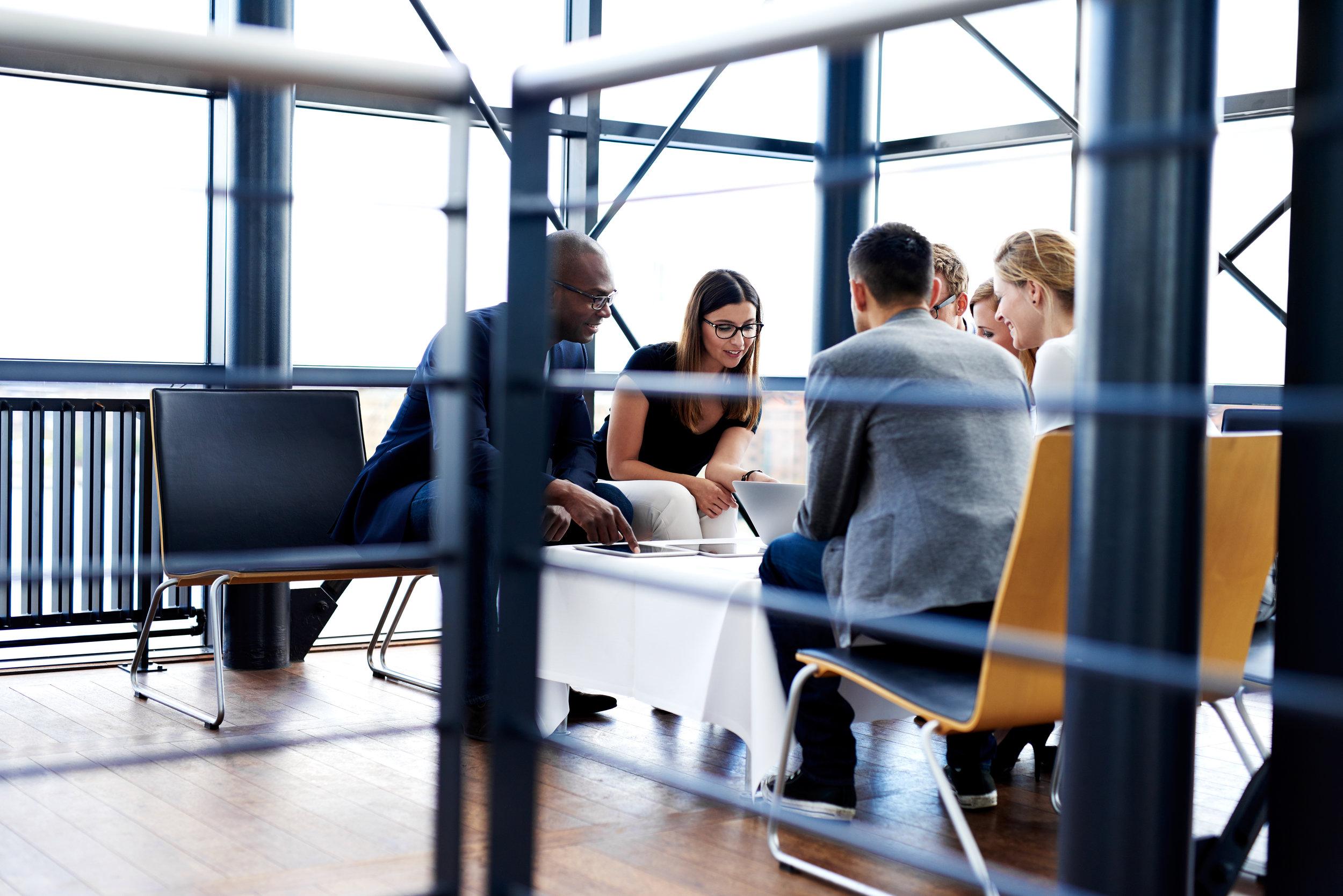 group-of-executives-sitting-together-and-working-PFNDYR7.jpg (6000×4004).jpg