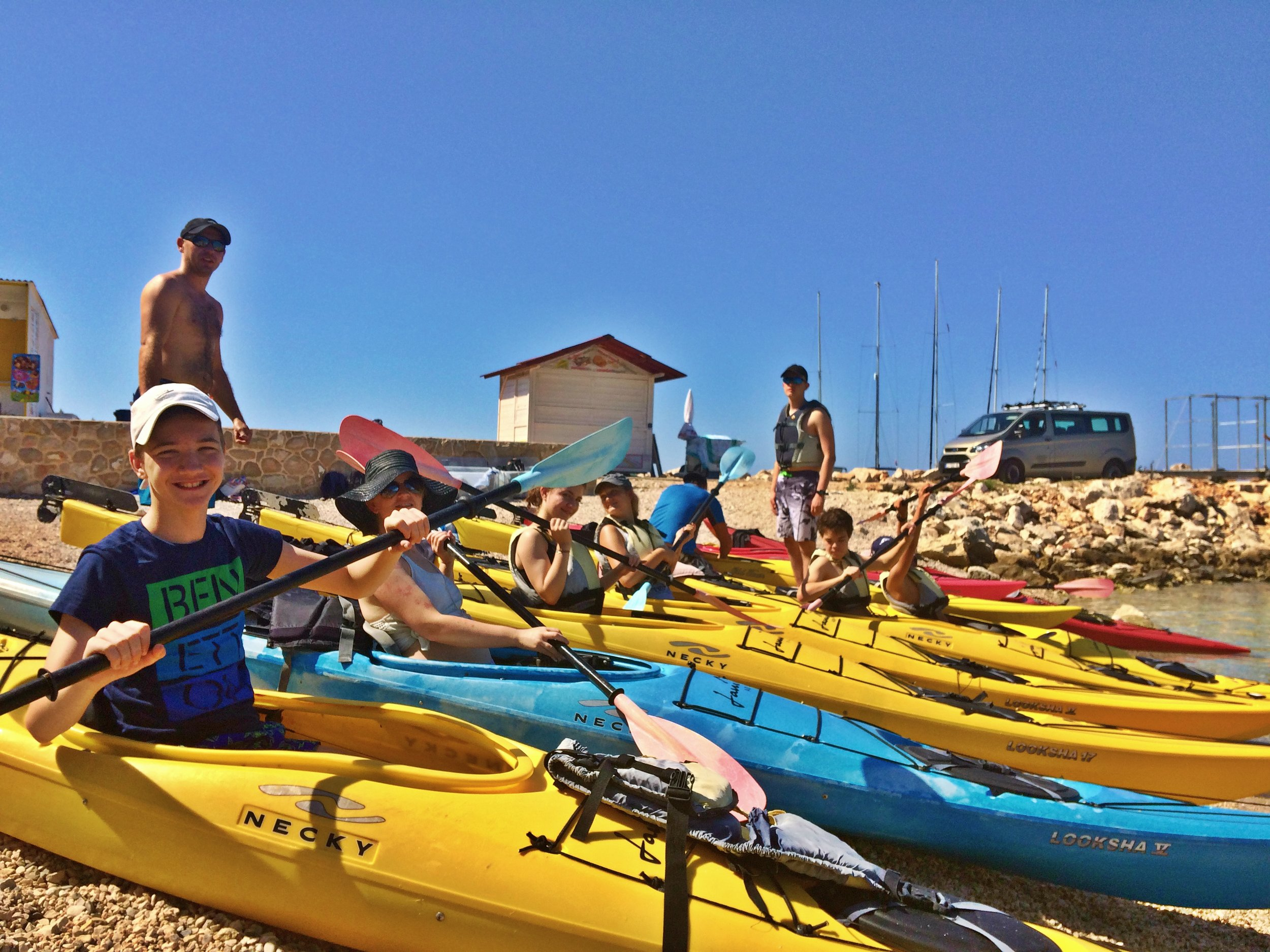kayaks with ivan at front smiling.jpg