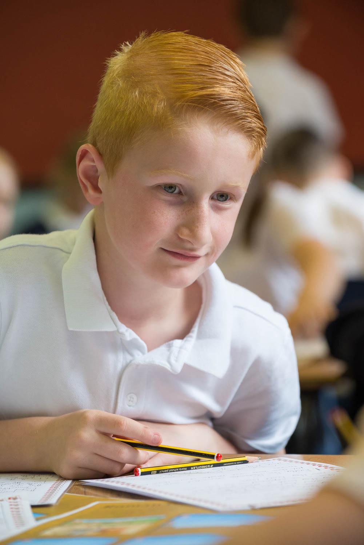School boy at desk