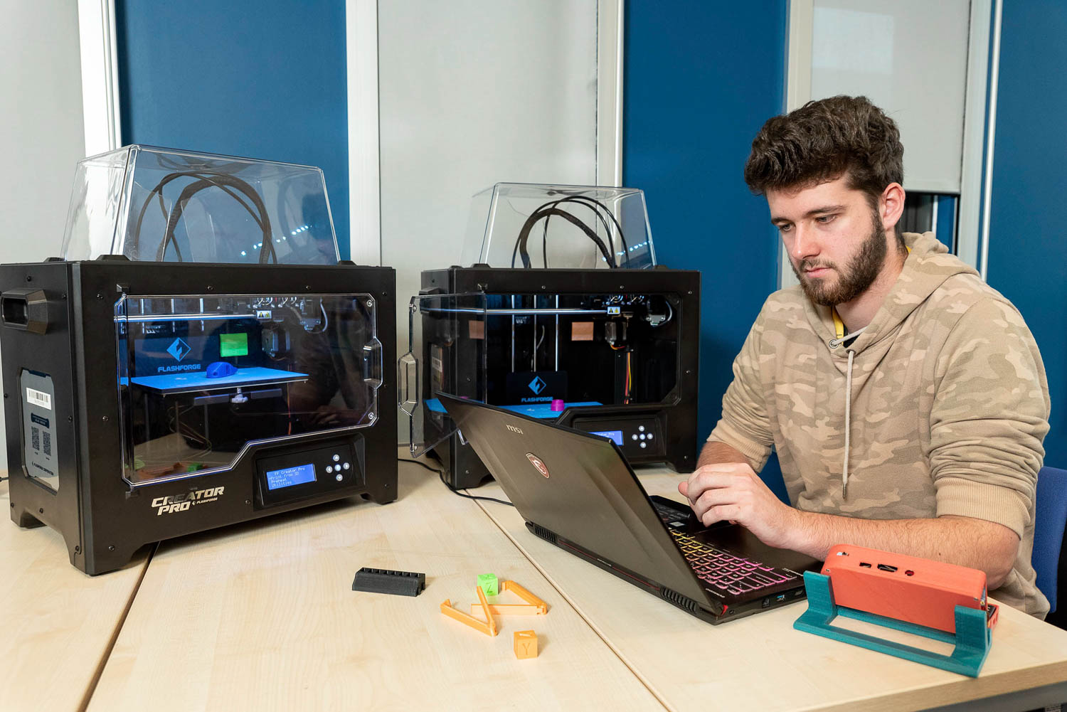 Student and 3D printers