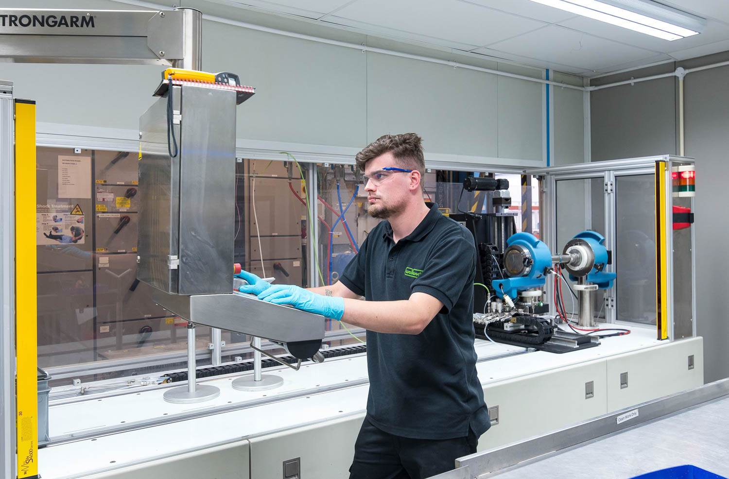 Man working at console in high tech lab