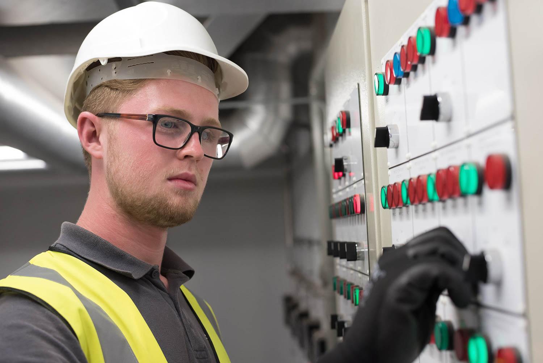 Man at work looking at control panel