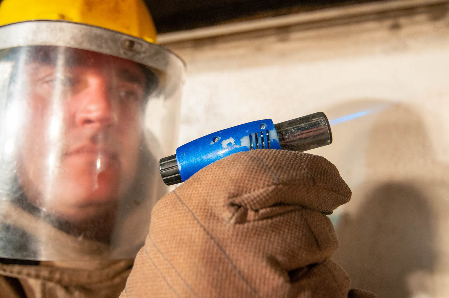 worker with blow torch