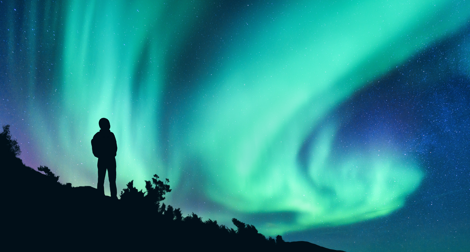aurora-borealis-and-silhouette-of-a-woman-with-3UB47KX.jpg
