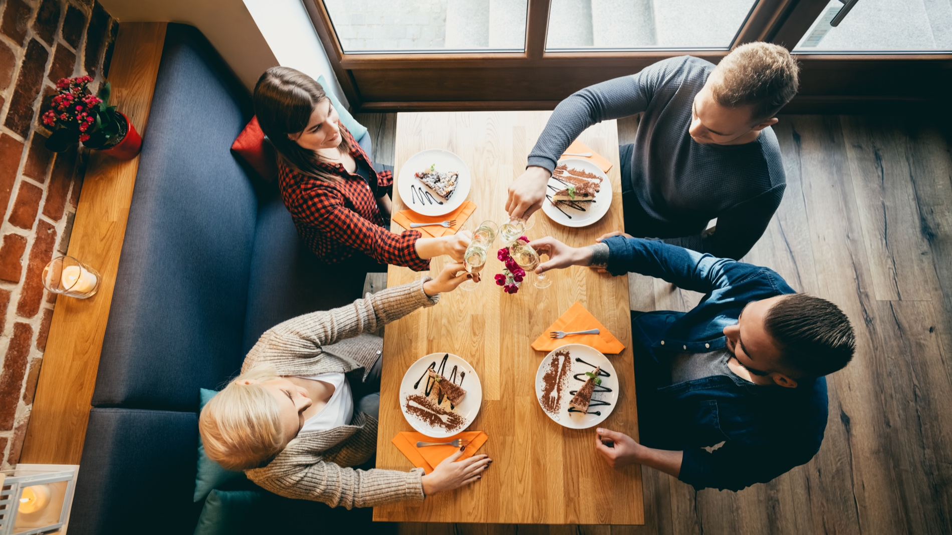 four-friends-toasting-in-a-restaurant-top-view-PLVMAMM.jpg