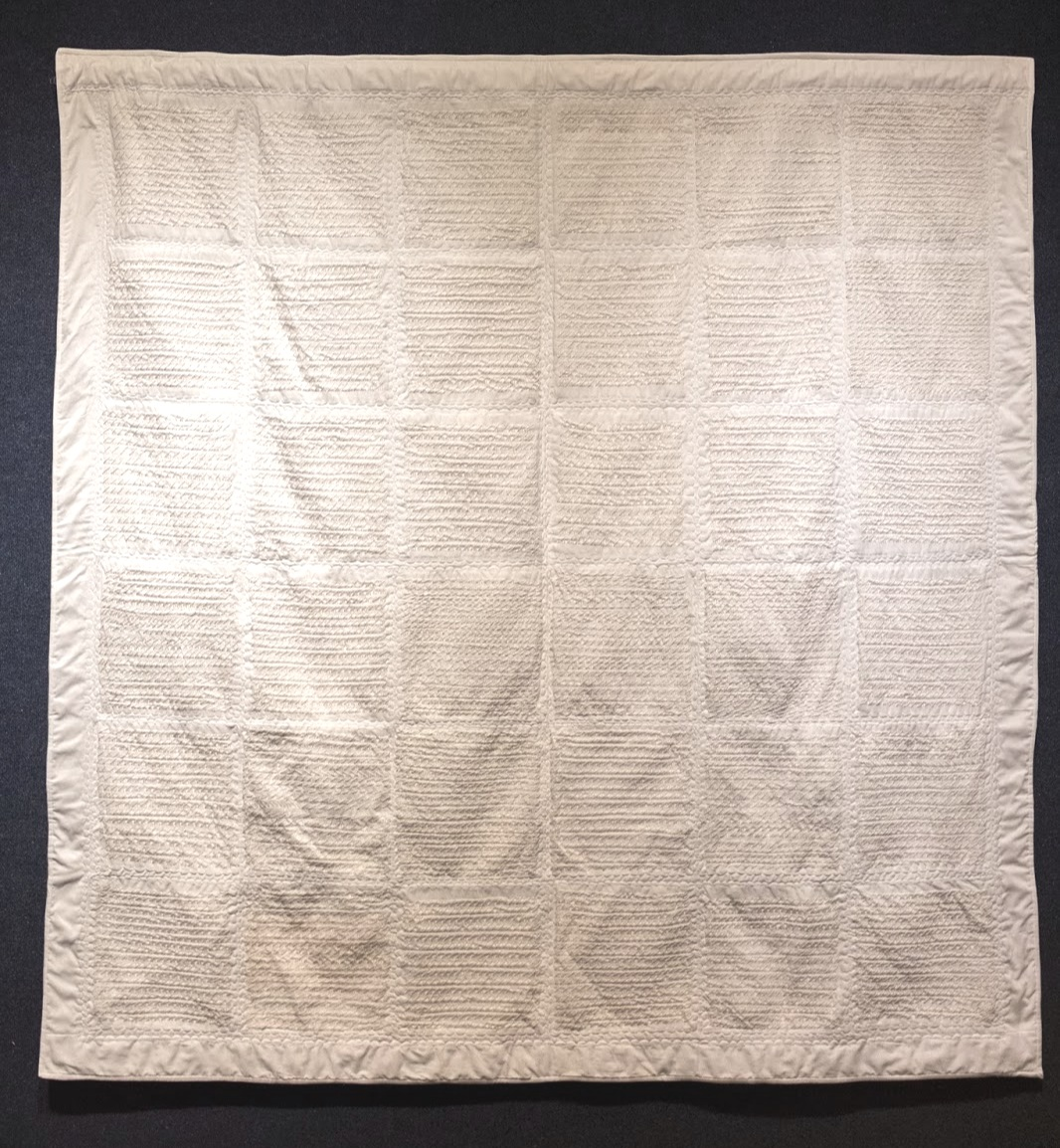 "White tally mark quilt. Crochet thread on white muslin, approximately 75,000 hand stitched tally marks, 72""x 72"""