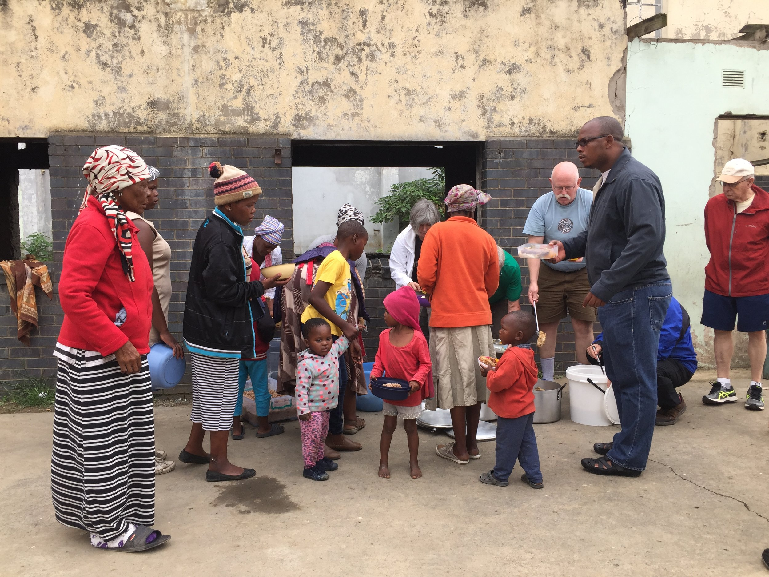 AIAIA food parcels help to feed families amidst the squalor of Sowetho
