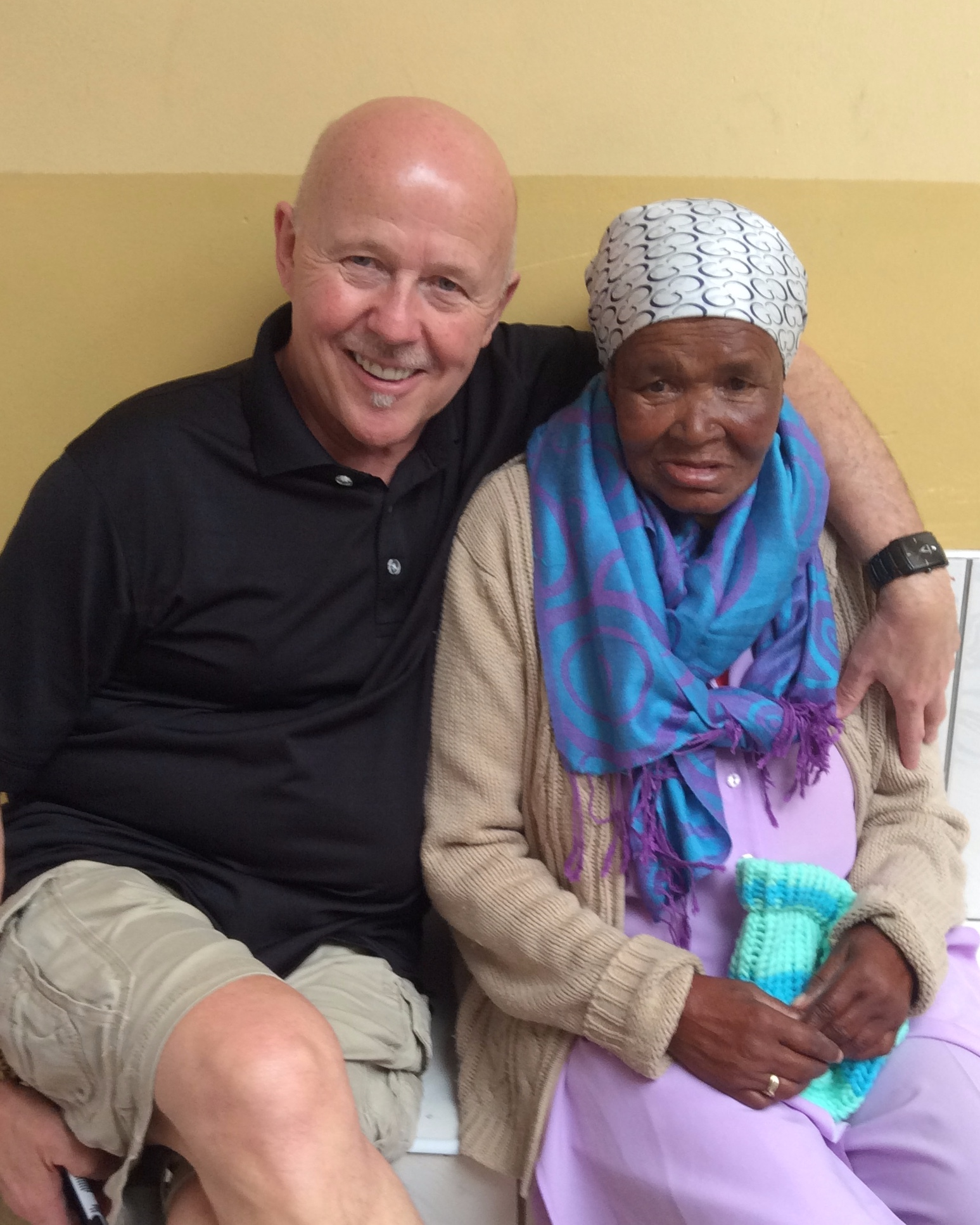 Jim Cassidy, AIAIA President, annually visits residents of the Missionaries of Charity home in Khayelitsha