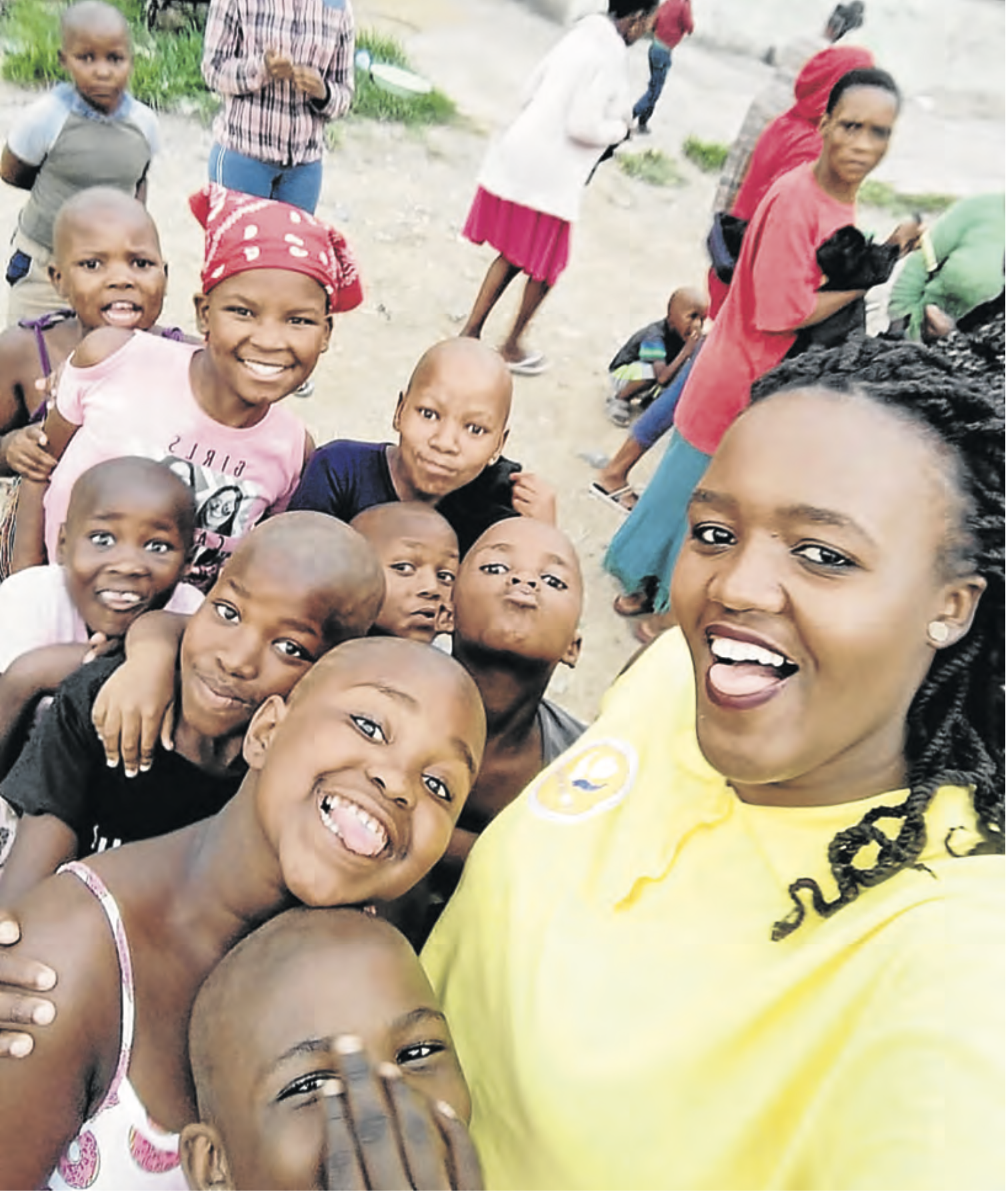 CARING: Noluvuyo Zintle Mehlomakhulu , dubbed Etipini 's Mother Teresa, with some of the children she assists. Picture: SUPPLIED