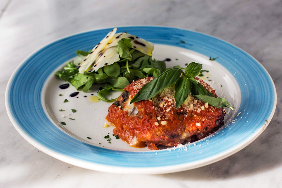 PARMIGIANA DI MELANZANE - Eggplant parmigiana with tomato sauce, mozzarella, basil and parmigiano.