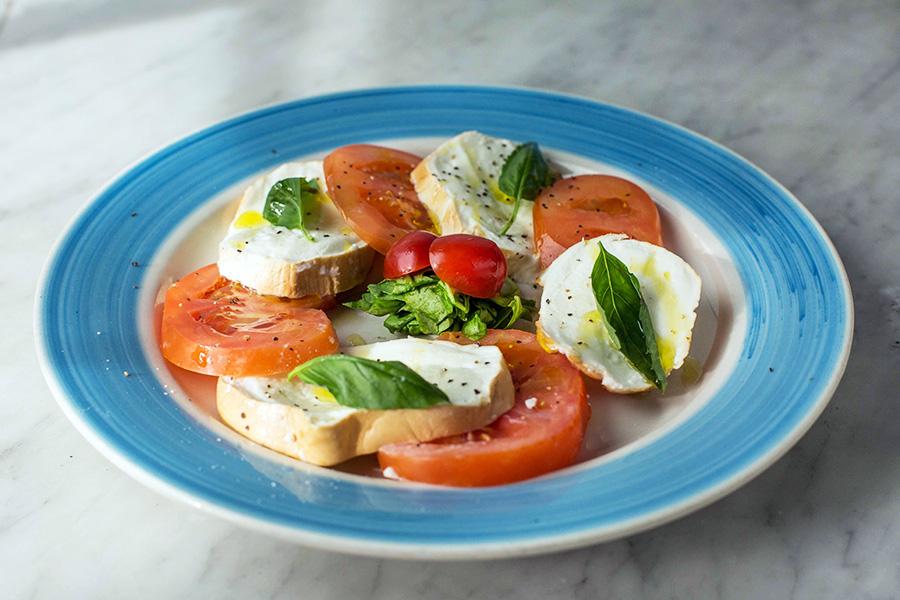 INSALATA CAPRESE - Imported buffalo Mozzarella with tomatoes, fresh basil and evoo.