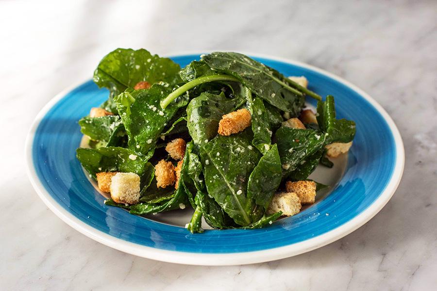 INSALATA DI CESARE - Baby kale, crostini, Parmesan and Caesar dressing.