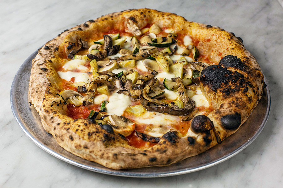 VEGETARIANA - Tomato sauce (san Marzano DOP eccellenze nolane), mozzarella (fiordilatte di agerola), zucchini, eggplant, mushrooms, artichoke, basil and extra virgin olive oil.