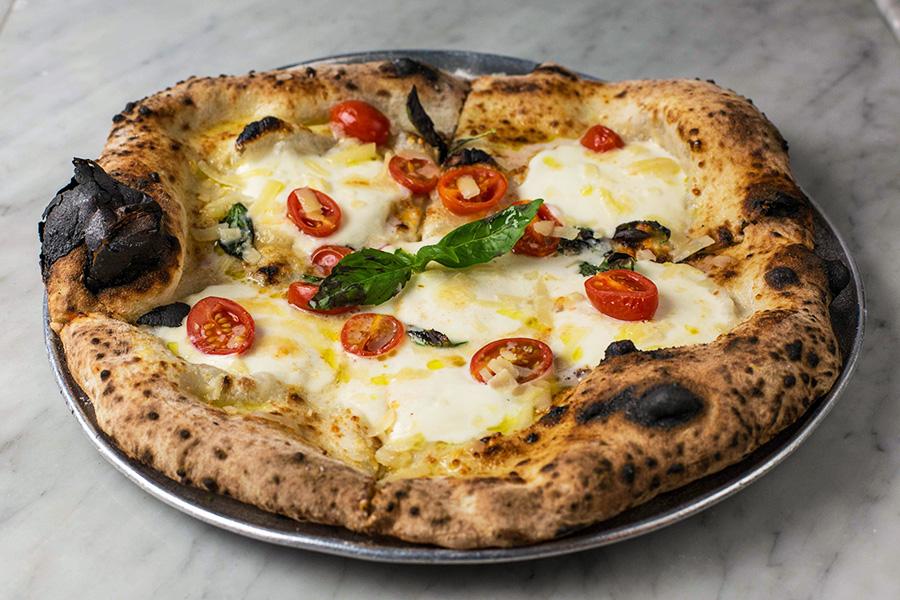 FILETTO DI POMODORI - Imported buffalo mozzarella, cherry tomatoes, shaved Parmigiano Reggiano, basil and extra virgin olive oil.