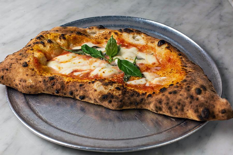 CALZONE CLASSICO - Filled with mozzarella (fiordilatte di agerola), spicy salami, ricotta, tomato sauce (san Marzano DOP eccellenze nolane) and basil.