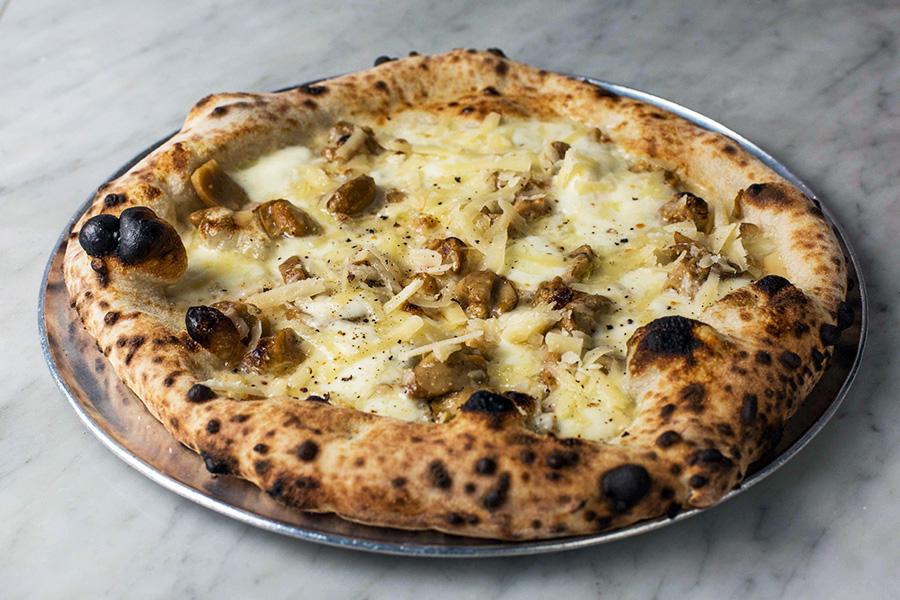 PORCINI - Porcini mushrooms, mozzarella (fiordilatte di agerola), shaved Parmigiano Reggiano and truffle oil.