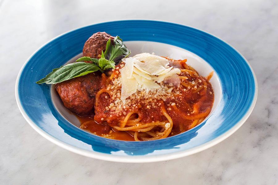 SPAGHETTI AL RAGU CON POLPETTE - Spaghetti with meatballs, tomato sauce and Parmigiano reggiano .