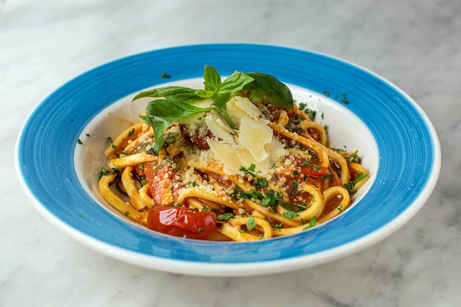 SCIALATELLI ALLA SCARPARIELLO - Homemade jumbo linguine with cherry tomato sauce, shaved Parmigiano reggiano and pepper flakes.