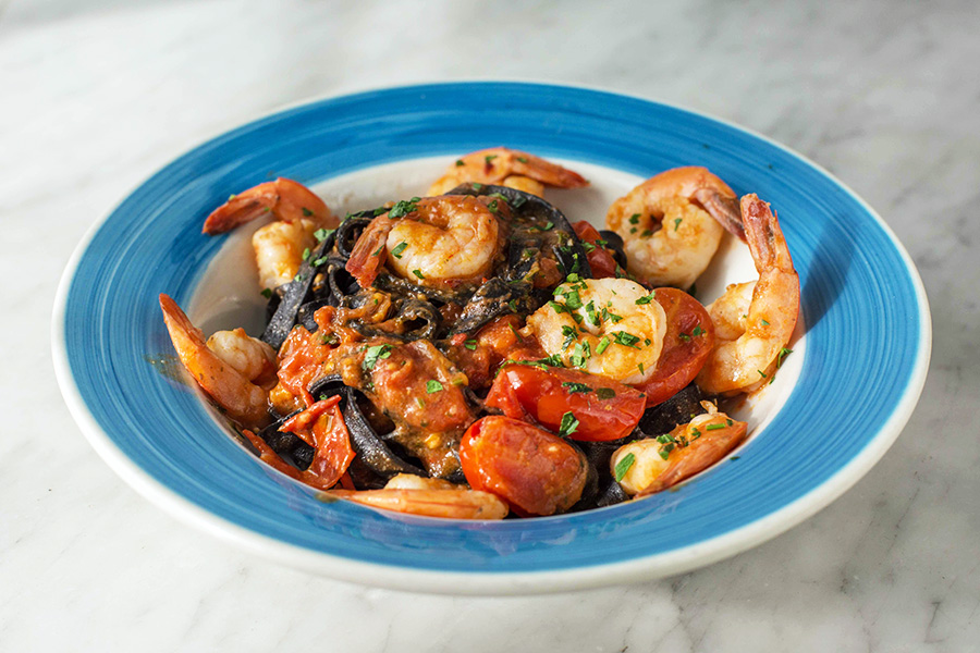 LINGUINE NERE CON GAMBERI - Homemade black (squid ink) linguine with shrimps, cherry tomato sauce and pepper flakes.