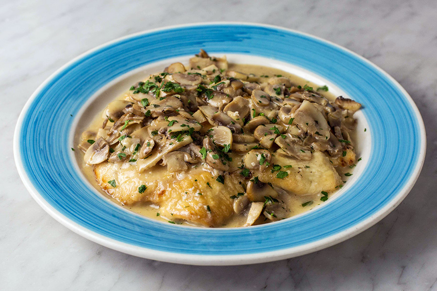 SCALOPPINA DI POLLO - Organic chicken breast with mushrooms in a white wine sauce.