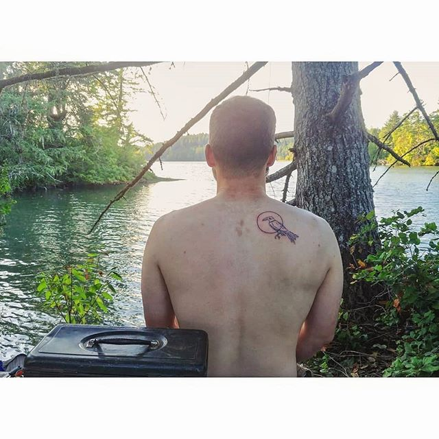 """Stoner Summer story: I asked my boss to tattoo me with our company's logo on my last day of work. Last week we had our first Raven tattoo💚 Brad was one of our first employees, and is moving to TN this week. A military vet that prides himself on never having done anything illegal [?!], he first tried cannabis after moving to WA post-legalization. He loved it. He was able to stop medicating with the daily handful of ibuprofen and found a totally different life path here in Olympia. His new job in TN does not allow cannabis use, and requires random drug testing. Back to the ibuprophen, and feeling a lack of ownership over decisions about his own physical and mental health. He asked if we could make the logo """"as big as we had time for"""" and on his back because """"I know Raven's always got my back"""". We smoked Blackberry Kush.  #stonersummer"""