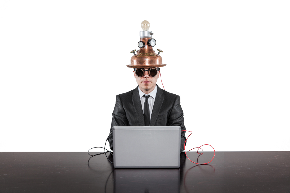 laptop mind hat WHITE AdobeStock_112744066-Edit.jpg