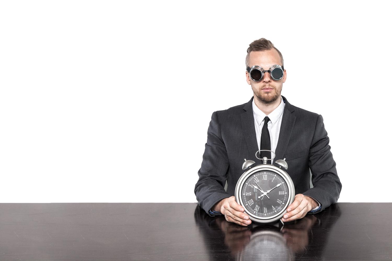 clock man on white right AdobeStock_113208143.jpg