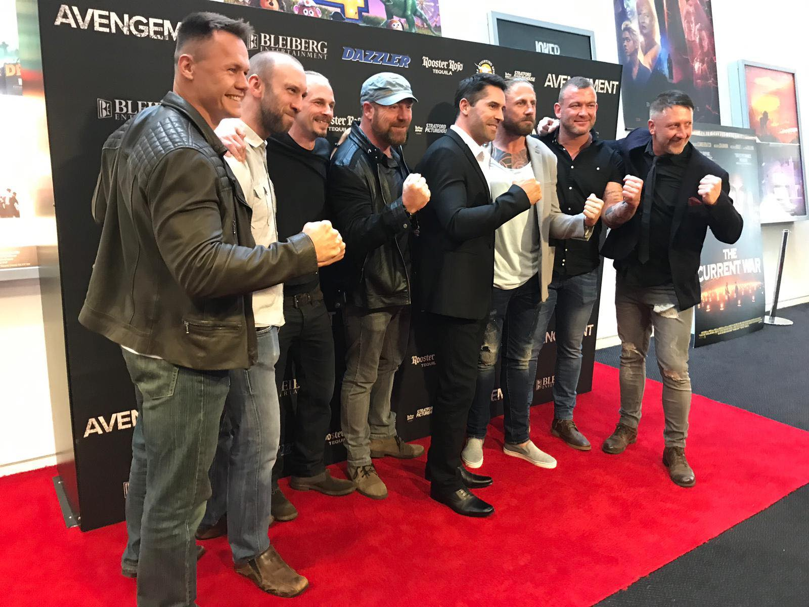 Justin Sysum (left) with other cast members and crew from Avengement at the film premiere