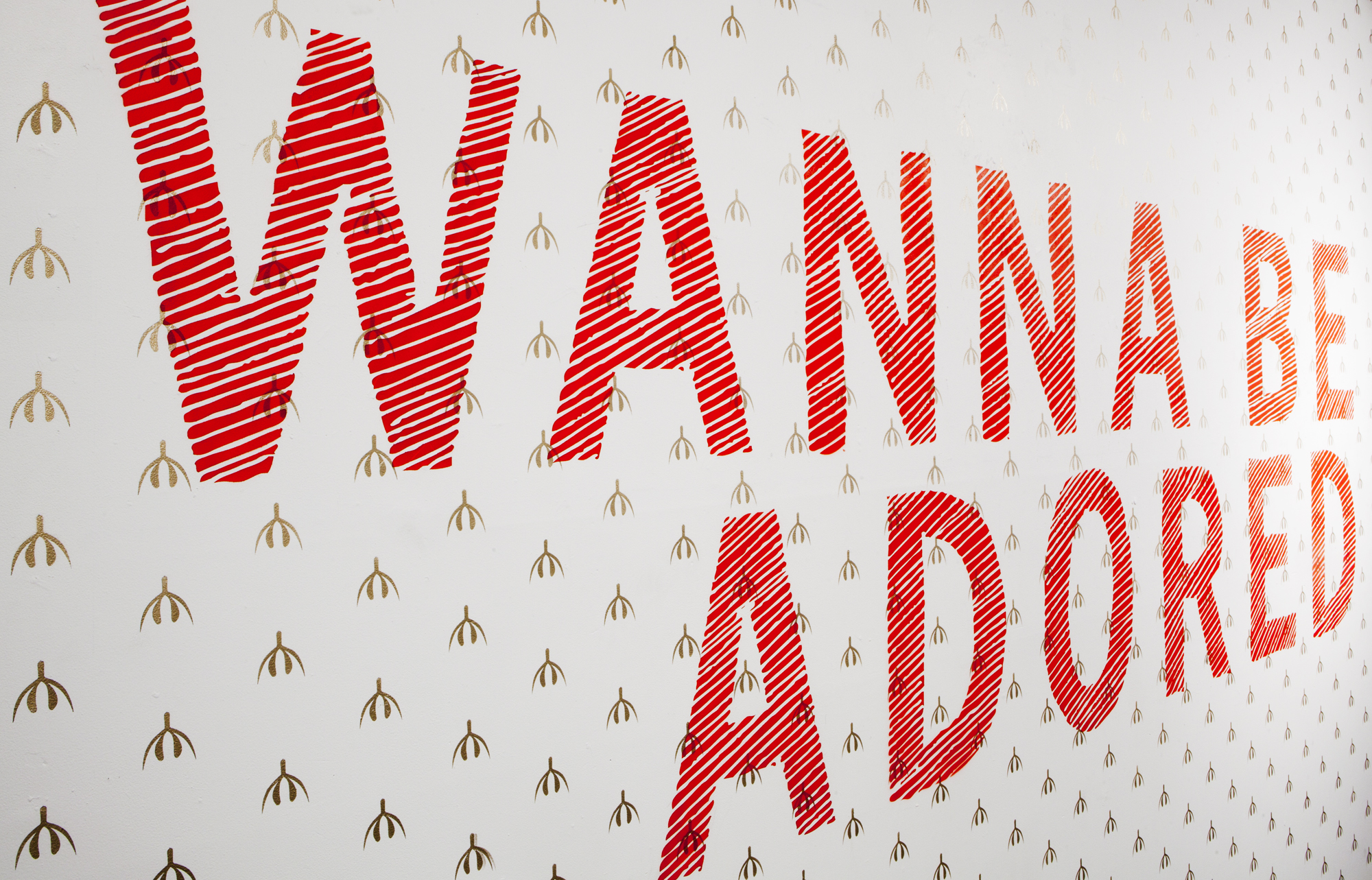 Site specific installation at  Definitely Superior Gallery   I WANNA BE ADORED, 2014  Gold, Red Acrylic 23 x 9 feet