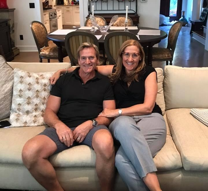 Pam Sherman with Joseph Nardone on the newly reupholstered couch