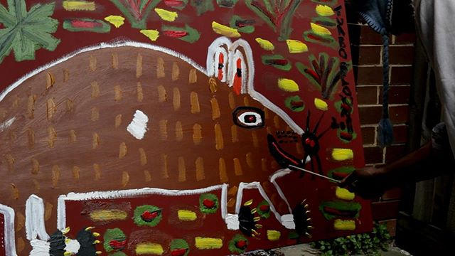 Still image of Turbo Trevor Brown working on 'Wombat foraging for food' 2012 in Brunswick, Melbourne. Acrylic on canvas. #turbobrown #aboriginal #art #makes #us #feel #alive \ (•◡•) / #madeinbrunswick #cityofmoreland #outsiderart #urbanart #koorieheritagetrust #melbournenow #nationalgalleryofvictoria #kreislergallery