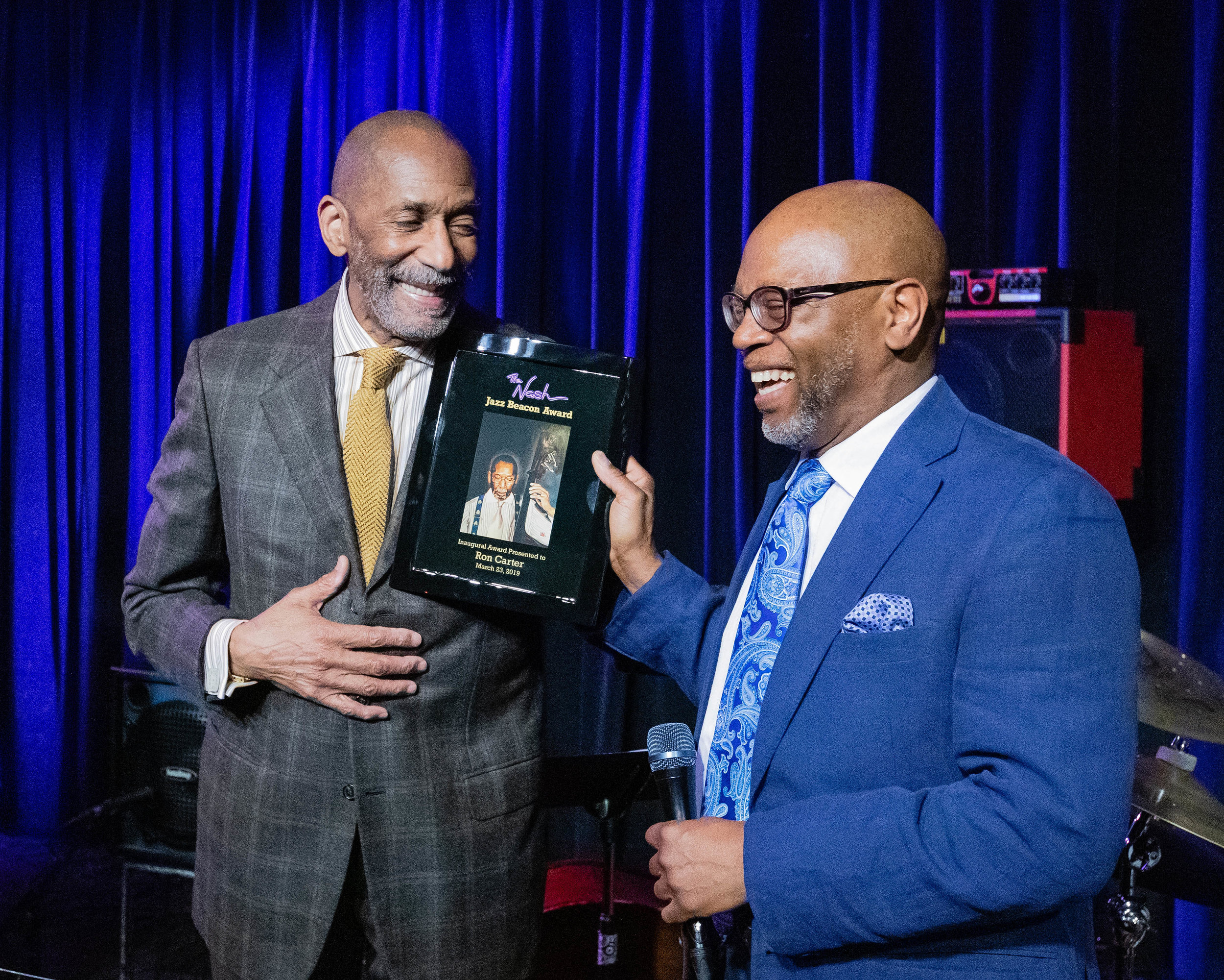 Bassist Ron Carter accepts The Nash Jazz Beacon Award from Lewis Nash.