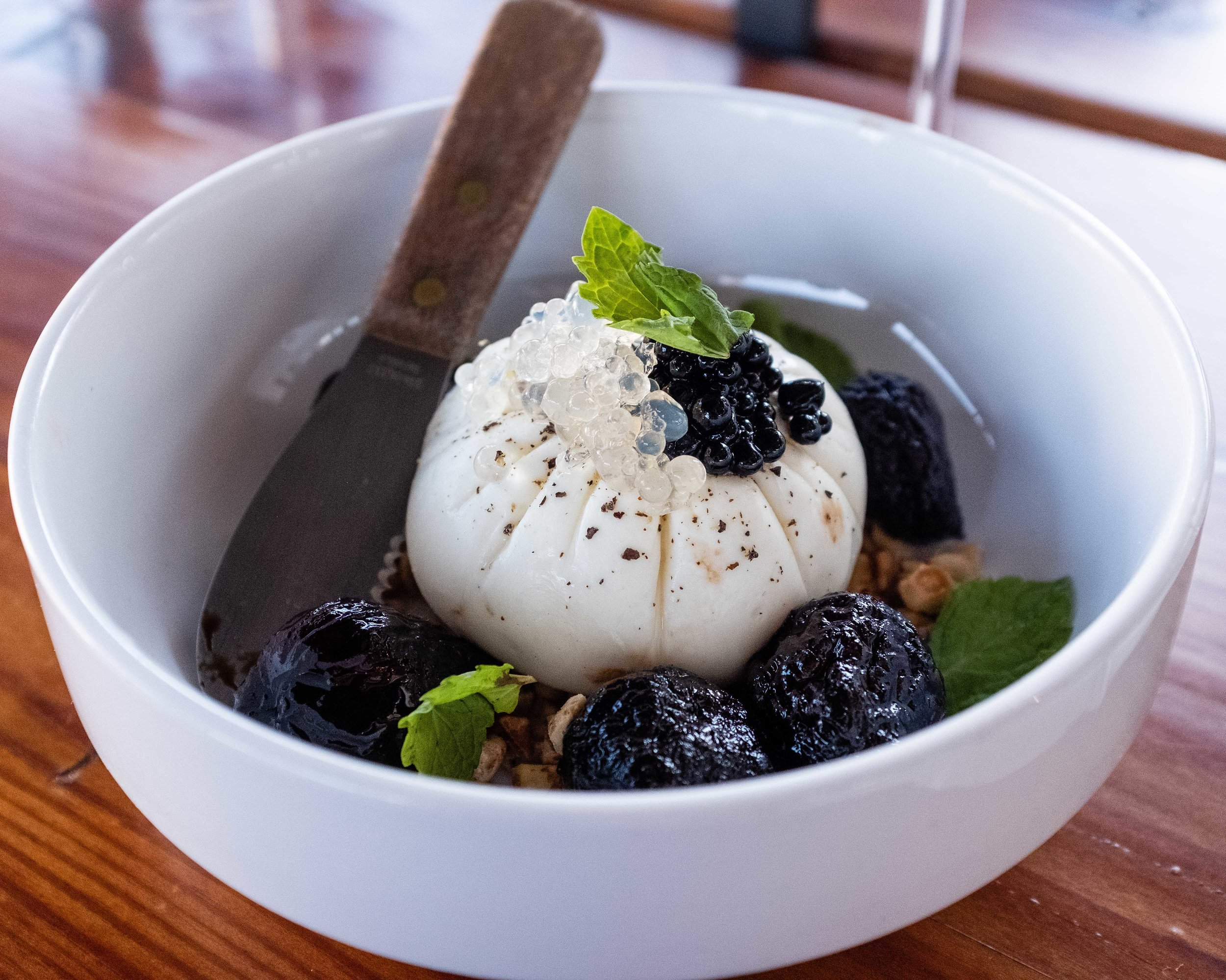 Smoked burrata with figs, champagne pearls, balsamic pearls, roasted nuts, and mint at Pizzicletta in Flagstaff, AZ - Joseph Berg lifestyle photography.