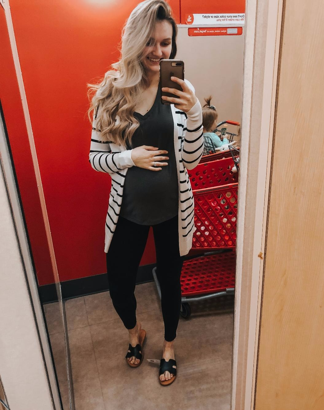 Black/White Striped Cardigan-  TTS. Wearing a small because its all they had, but would get medium.   Green Tee-  TTS, wearing medium.   Maternity Leggings-  Run big, wearing size small.   Black Sandals-  TTS
