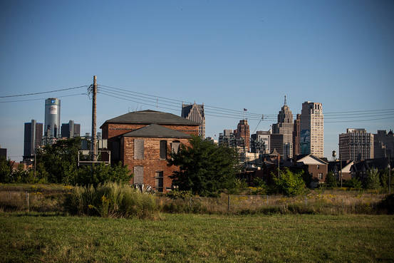 An abandoned home is seen with the Detroit skyline in the background.  GETTY IMAGES