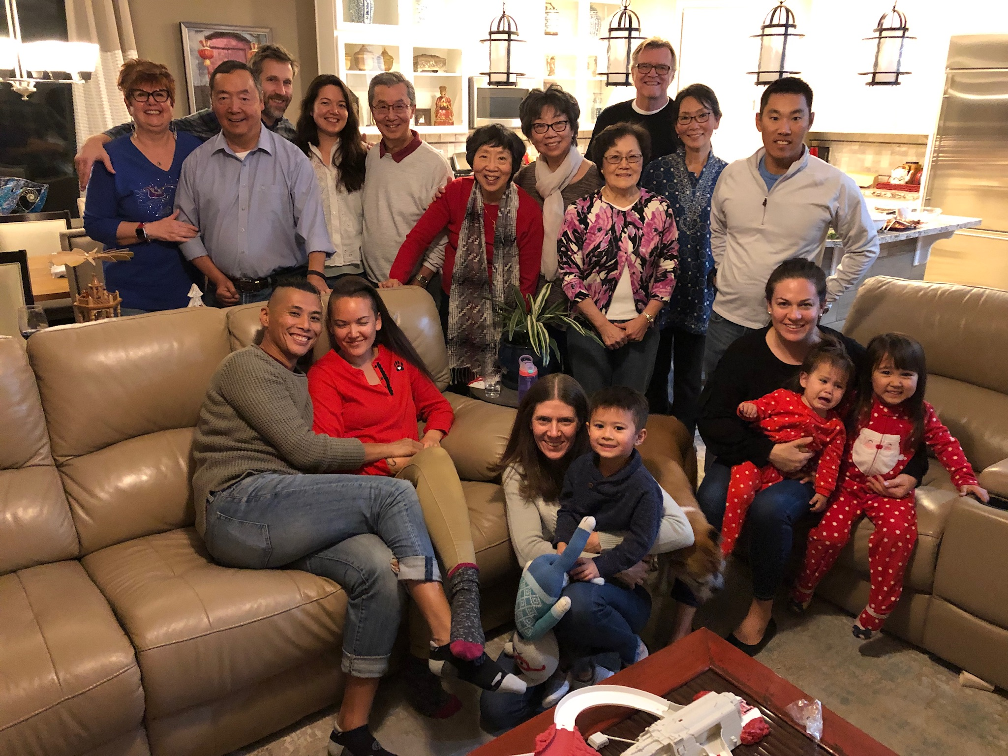 Whitney (bottom left, in red, with her eyes closed) with some of her family and relatives celebrating Christmas (2018). Every child in the family's youngest generation is a special variety of mixed race.