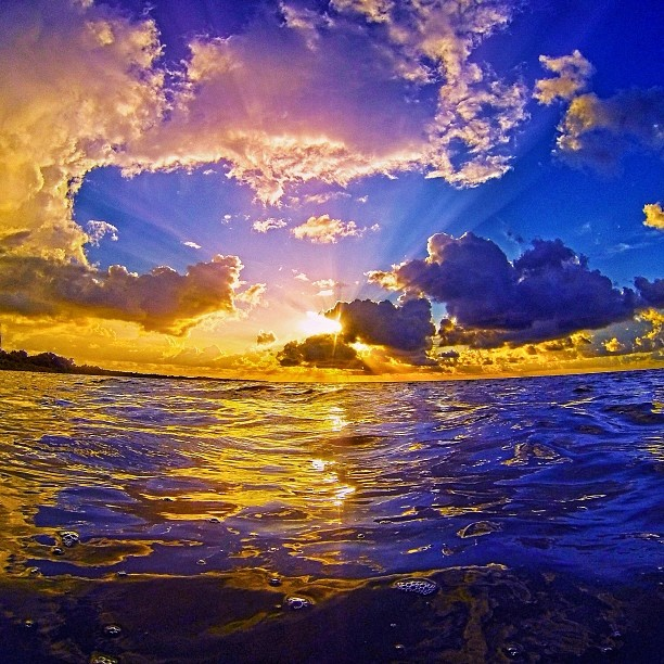 a-purple-pink-blue-and-yellow-gold-sunrise-over-the-atlantic-ocean-just-off-shore-from-campgrounds-a_t20_k0ng2p.jpg