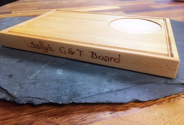 A custom made, solid beech gin pairing board. A perfect wood gift, made as a gift from a husband whose wife loves her gin. With a place for her glass to rest, and engraved for a special personalised touch.