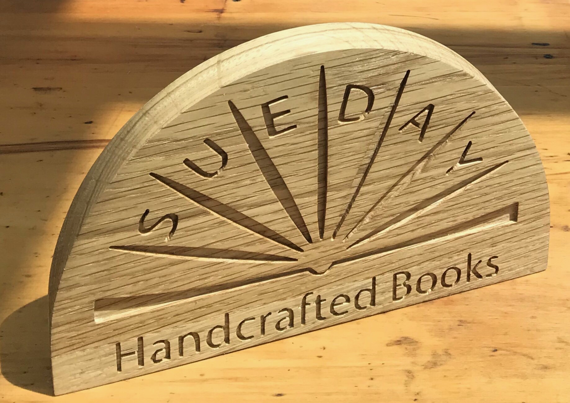 We have absolutely loved working with Sue to create this fabulous Solid Oak sign with her very own business logo. It is beautiful and unique and will add a further professional touch to her handmade book stall.  Sue handcrafts her books using traditional bookbinding skills and gives them a more contemporary look. Find out more and check out her store  here