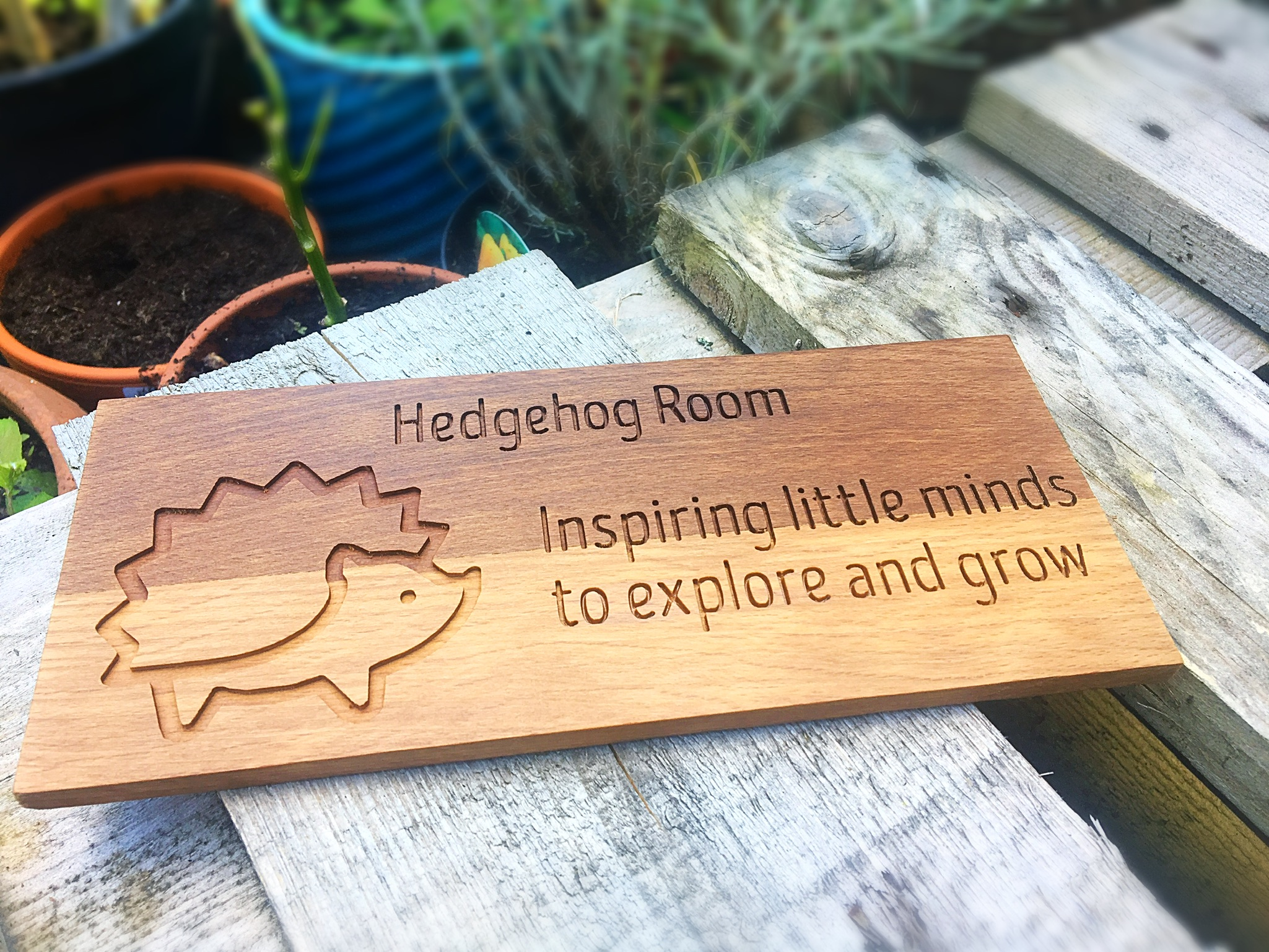 This was recently made for a client who wanted a unique gift for the staff at her son's pre-school, to thank them for all their hard work and support. It was engraved with a personal message on the back, making it that extra bit special. Made from a beautiful piece of walnut, which really brings out the detail in the design.
