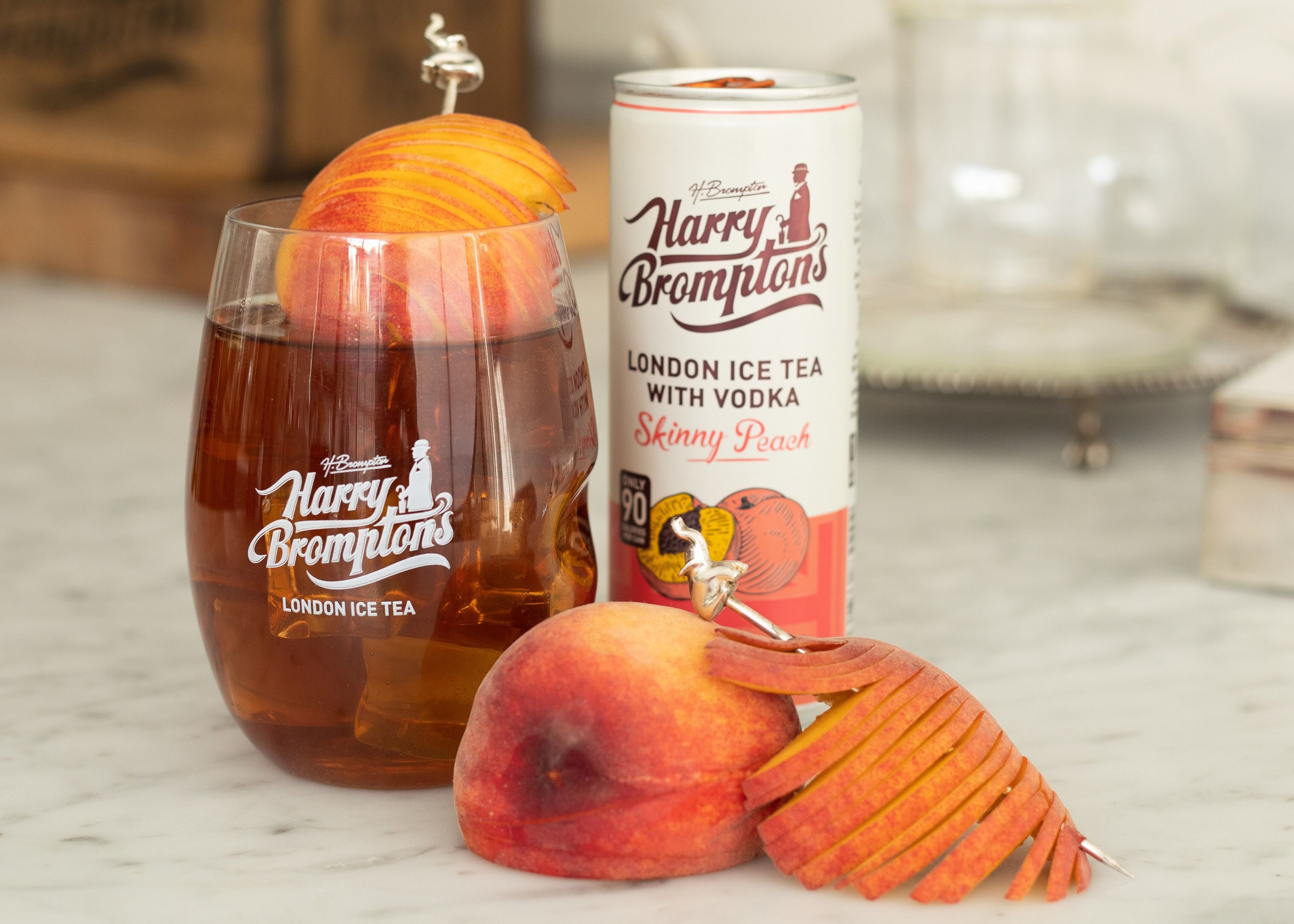 BLACK TEA AND VODKA WITH PEACH - The perfect combination of Harry's Peach Ice tea and Vodka. Lightly sparkling and low in sugar and calories.