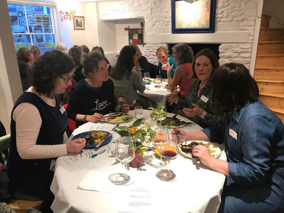 Women enjoying their meal.